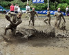 This Muddas Football Club runner (left) briefly excapes his persuers, during the World Mud Bowl Championship game, in North Conway, NH, on September 13th, 2009. The Muddas went on to defeat their opponents, the Nashua Mud Gumbys, who had won this event for the past two years.