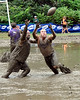 These two mud football players try to catch the ball, during a preliminary game of The World Mud Football Championship, being held at Hog Coliseum, in North Conway, NH. The event concludes Sunday, Sept. 13th, when the Mudbowl champion will be crowned.