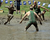 This Mudders Football Club player drives toward two Nashua Gumby defenders, during the final game of the World Mud Football Championships, held in North Conway, NH, on Sept. 13th, 2009. The Mudders went on to win the game, and the championship, the 17th in the team's history.