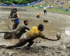 This North Shore Mud Shark gets his fingertips on the ball, but is unable to hold on, during Saturday game action of The World Mud Football Championships, held Sept. 11-13, at Hog Coliseum, in North Conway, NH.