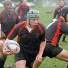Josh Longenbaker looks for room to run during the Ohio Rugby Classic at Lou Berliner Park on Saturday.