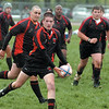 Josh Barkhurst of the Westerville Worms looks to pass during the Ohio Rugby Classic at Lou Berliner Park on Saturday.