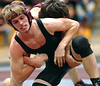 Dobyns Bennett's Bradley Hoover escapes from the grasp of Science Hill's Michael Goldstein in the 140 class match. Photo by Ned Jilton II