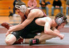 Who's got who as Science Hill's Brett Usary and Dobyns Bennett's Jacob Fry battle for an advantage in the 135 lbs class. Photo by Ned Jilton II
