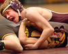 Dobyns Bennett's Adam Mann looks up at the referee as he attempts to pin David Crocketts Casey Payne in the 103 class. Photo by ned Jilton II