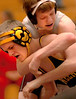 Austin Mann of Dobyns Bennett attempts to hold onto David Crockett's Thomas Snyder in the 112 lbs class action. Photo by ned Jilton II