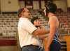 Grant Gibson of Sullivan South is congratulated by his coach after competing in their first wrestling match in school history as Casey Williams suits up for her match. Photo by Erica Yoon