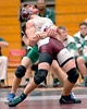 Dobyns Bennett's Adam Metzger is bent backwards by Greeneville's Thomas Willett as he tries to avoid takedown in 140 lbs action. Photo by Ned Jilton II