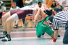Dobyns Bennett's Keith Gilliam arches his back in an effort to escape from Greeneville's Victor Medina in the 160 class match. Photo by Ned Jilton II
