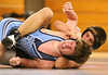 Sullivan South's Dave Ketron grimaces as Keith Gilliam of Dobyns Bennett has a tight hold on him during a wrestling match. Photo by Erica Yoon
