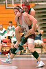 Greeneville wrestler jumps on the back of Dobyns Bennett's Jackson Cox in the 171 class match. Photo by Ned jilton II