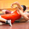 Steven Breen of D-B goes for the pin against South Doyles Harrison Jenkins in the 171 lbs class. Photo by Ned Jilton II