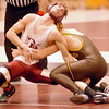 D-B's Bradley Hoover attempts to escape from the grip of David Crockett's Josh Thomas during 140 lbs match at Dobyns Bennett. Photo by Ned Jilton II