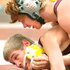 Science Hill's Jonathan Peirce battles both his own head gear as well as Dobyns Bennett's Adam Mann in the 119 lbs class. Photo by Ned Jilton II