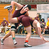 Dobyns Bennett's Craig Carter throws Science Hill's Josh Lewis in 215 lbs match. (check spelling of name as they came second hand from announcer) Photo by Ned Jilton II