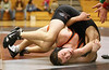 Morristown East Chris Majors and Dobyns-Bennett Jacob Pewitt in the 152lbs. weight class. Photo by Erica Yoon