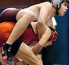 Dobyns Bennett's Bryson Begley jumps on top of and brings down Cocke Couty's Leo Woods during 145 lbs class match. Photo by Ned Jilton II