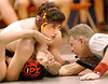 Dobyns Bennett's Christopher Stout holds Cocke County's Cody Reed on the mat while waiting for the official to call a pin during the 152 lbs class match. Photo by Ned Jilton II