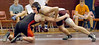 Dobyns Bennett's William Gilliam attempts to get position on Cocke County's Cody Bible in 140 lbs class match. Photo by Ned Jilton II