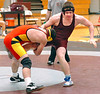 Dobyns Bennett's Jake Stidham, right, tries to avoid being taken down by Daniel Boone's Trevor Shropshire in the 189 lb class. Photo by ned Jilton II