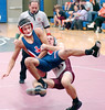Dobyns Bennett's Bobby Lemaster brings down Jefferson County's Daniel Evon in 130 lbs class match. Photo by Ned Jilton II