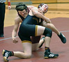 Will Lynch of Dobyns Bennett battles with Science Hill's Sam Arms in the 171 lbs class. Photo by Ned Jilton II