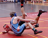 Dobyns Bennett's Bobby Lamaster hits the mat as he tries to take down Sullivan South's Tyler Yoakley, wearing blue, during the 125 lbs consolation match in the Region 1-AAA. Photo by Ned Jilton II
