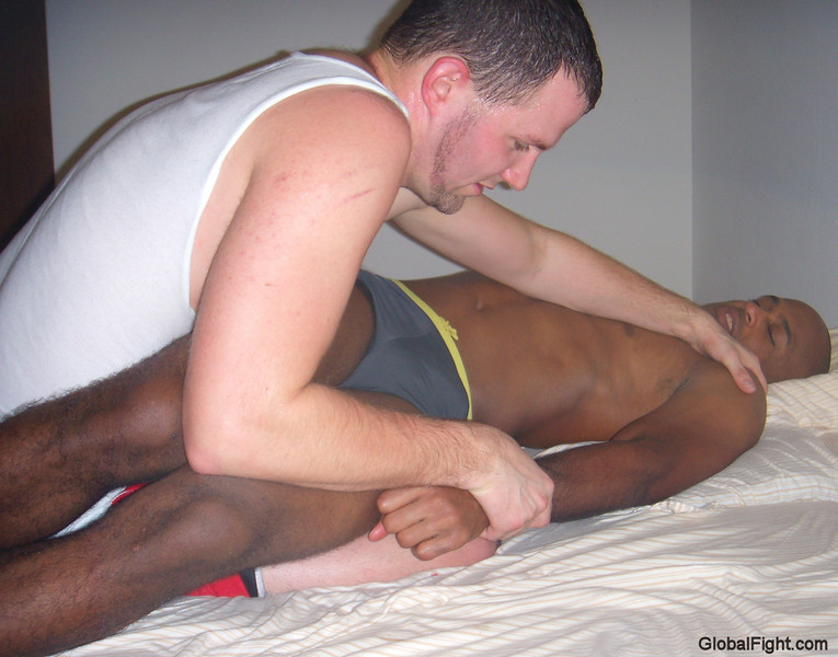 a sweaty gay dudes apartment hotel wrestling pics