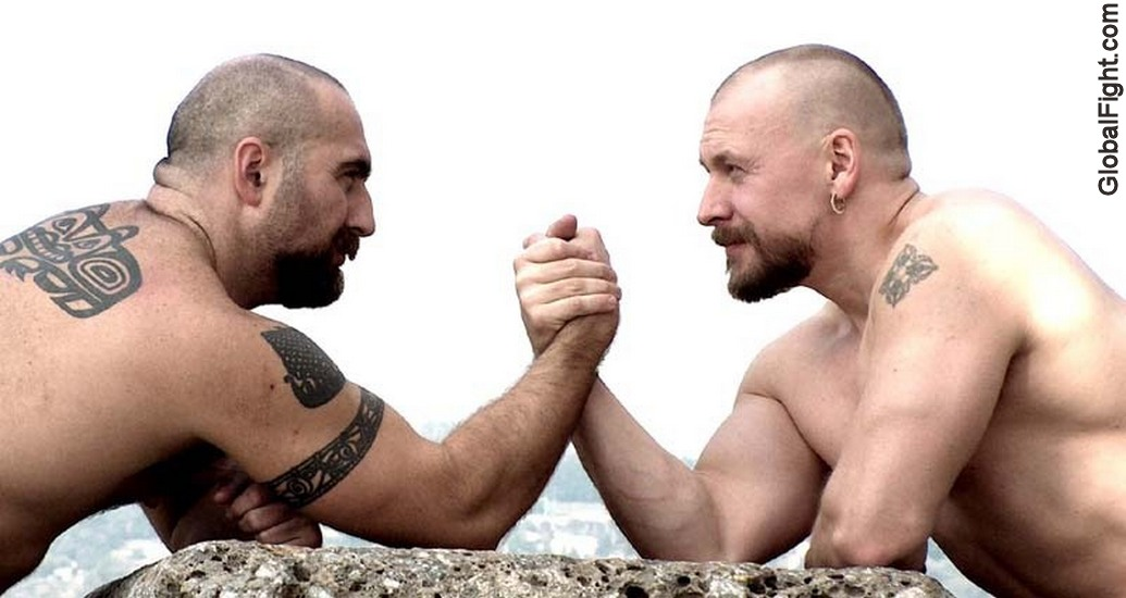 a tattooed gaymens  bikers arm wrestling