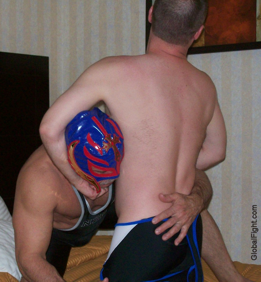 a son choking dad wrestling match beating pops