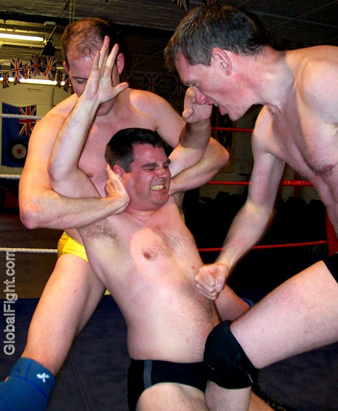 a tagteam wrestling trio beat down opponents
