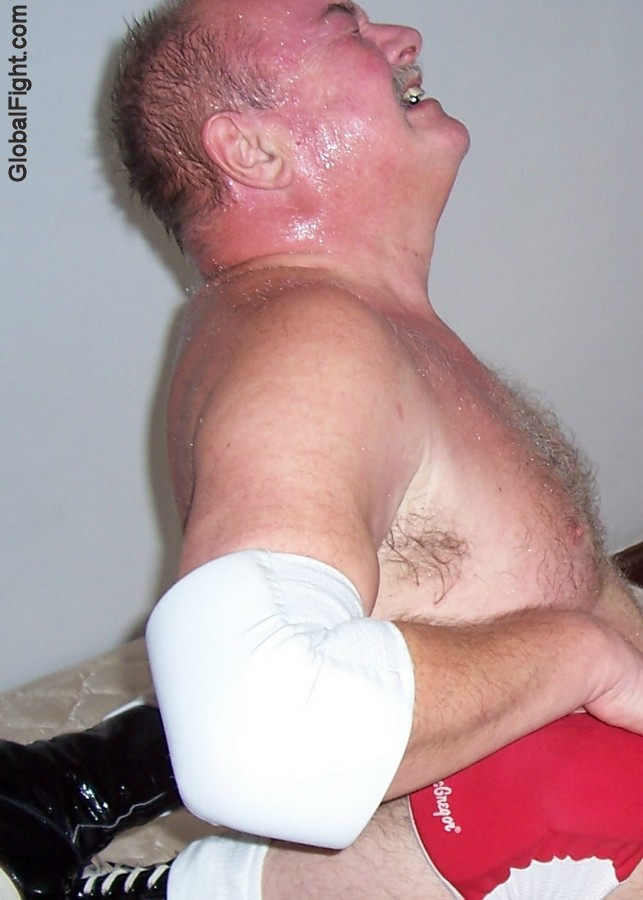 a sweaty big thick neck manly bear wrestling home webcam