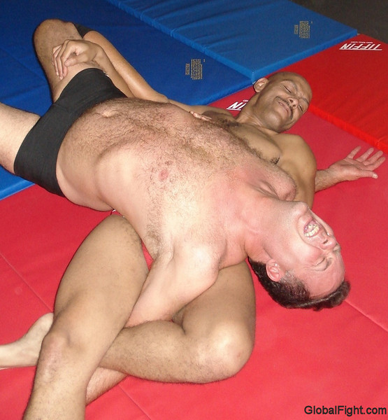 a torturing hunky wrestler hairychest pecs arm pits