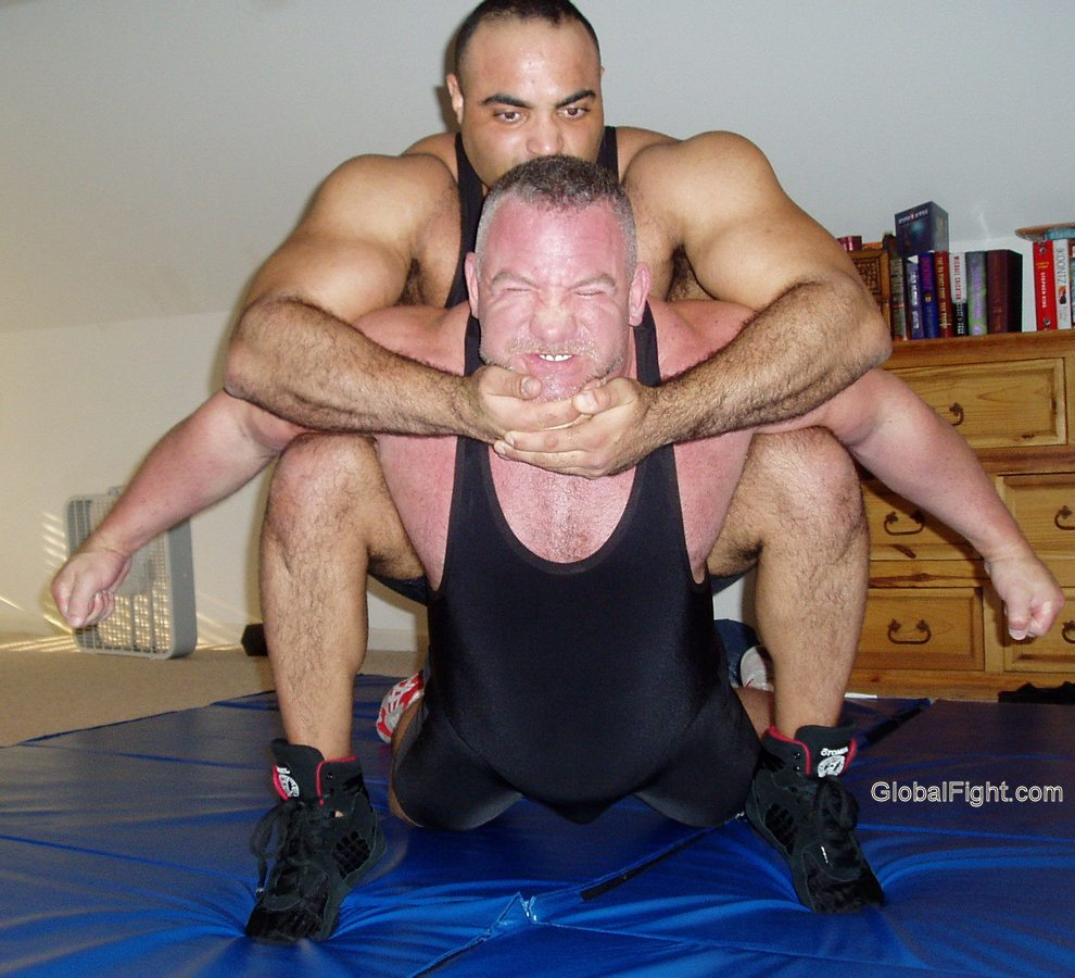 a stretching out sweaty daddy fighter wrestling mats