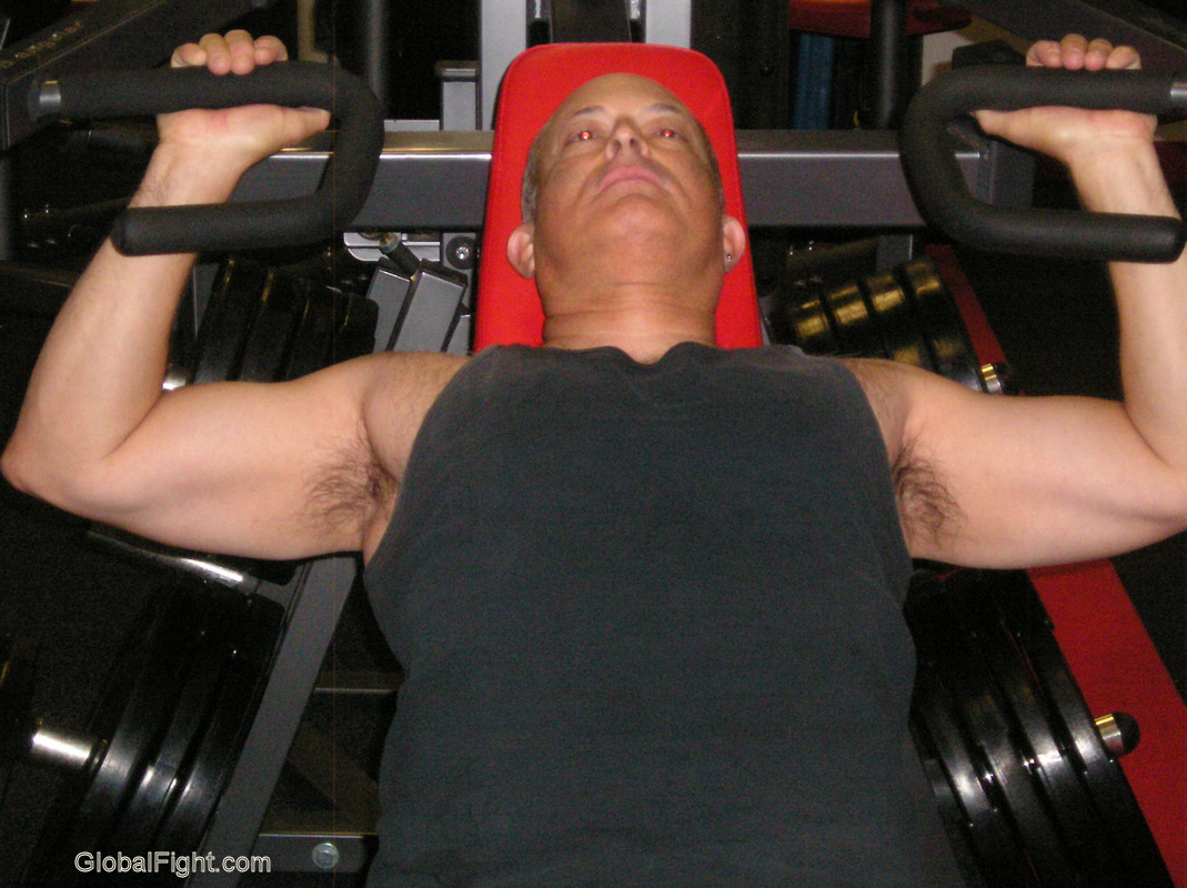 hairy man gym trainer incline press