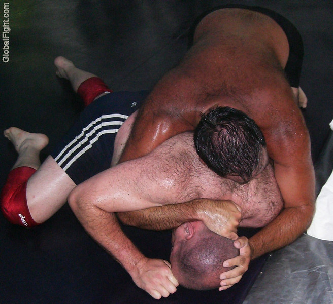 a sweaty men wrestling backyard fighting manly guys