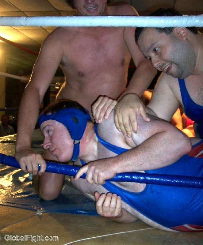 a three guys wrestling man having his way with sexy buddies