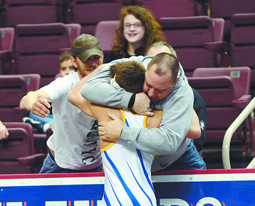 Line Mountain's Cameron Newman hugs fans after winning his round two consolation match against Brookville's Taylor Ortz in the 106lb weight class on Friday morning in Hershey.