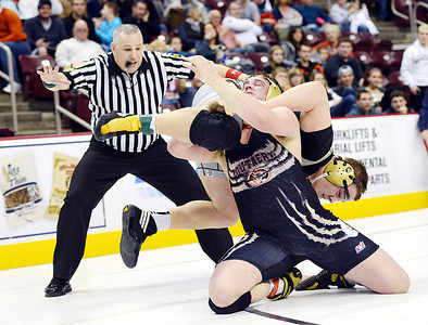 Southern Columbia's Jake Becker lifts Bethlehem Catholic's Andrew Dunn during a quarterfinal bout in the 285lb weight class on Friday morning in Hershey.