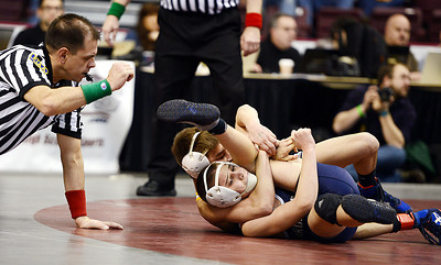 Line Mountain's Cameron Newman attempts to pin Brookville's Taylor Ortz in a second round of consolations on Friday morning in Hershey.