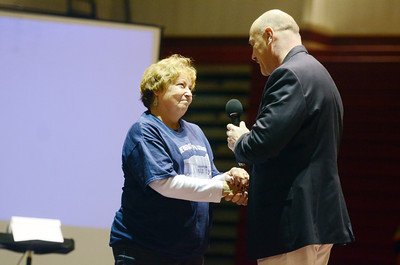 Liz Lockcuff, widow of Phil Lockcuff, shakes hands with Pat Kelley, Shikellamy's Superintendant, after he declares the high school gymnasium the Phil Lockcuff Gymansium on Saturday afternoon in Sunbury.