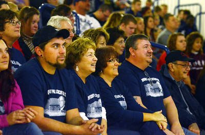 Liz Lockcuff, widow of Phil Lockcuff, center, along with other members of the family, laughs during the dedication ceremony for the Phil Lockcuff Gymnasium at the Shikellamy High School on Saturday afternoon in Sunbury.