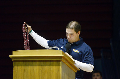 Brett Michaels, former Shikellamy varsity wrestling coach, chokes up while talking about the lucky tie that Phil Lockcuff gave him during the dedication ceremony for the Phil Lockcuff Gymnasium at the Shikellamy High School on Saturday afternoon.