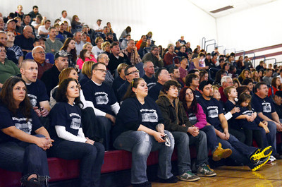 Family and friends of Phil Lockcuff, former Shikellamy wrestling head coach, listen to the dedication ceremony for the newly named Phil Lockcuff Gymnasium at Shikellamy High School on Saturday afternoon.