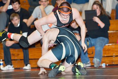 Brandon Stokes of Milton, top, wrestles Austin Swoyer of Western Wayne during the Northeast AA PIAA wrestling tournament in Williamsport on Saturday.