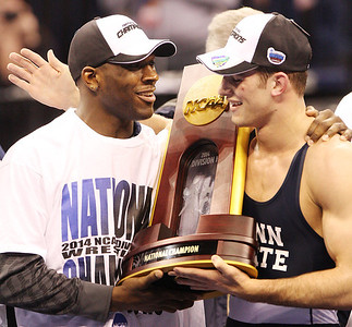 National champions Ed Ruth, left, and David Taylor, congratulate each other after helping lead Penn State to its fourth NCAA team title in a row. (Tim Tushla/For The Daily Item)