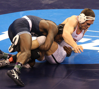 Penn State senior Ed Ruth finishes a takedown against Maryland's Jimmy Sheptock in the 184-pound final on Saturday. Ruth won 7-2. (Tim Tushla/For The Daily Item)