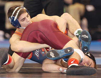Bucknell's Paul Petrov tries to gain control of Virginia Tech's Joey Dance in a 125-pound bout at the NCAA championships. (Tim Tushla/For The Daily Item)