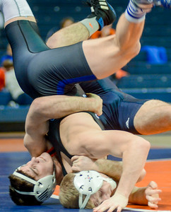 Bucknell's Tyler Smith and Franklin and Marshall's Paddy Quinlan roll out of bounds during their 141 lb match at the Sojka Pavilion on Tuesday night.
