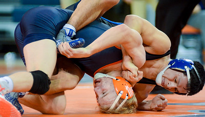 Bucknell's Jordan Gessner works on escaping from Franklin and Marshall's Edgar Garcia during their 125lb match inside the Sojka Pavilion in Lewisburg on Tuesday night.